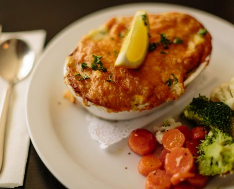 Fish pie served with seasonal vegetables